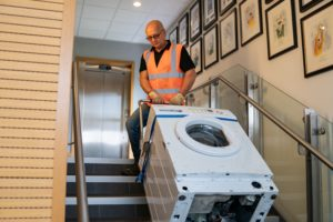 moving white goods on the stairs
